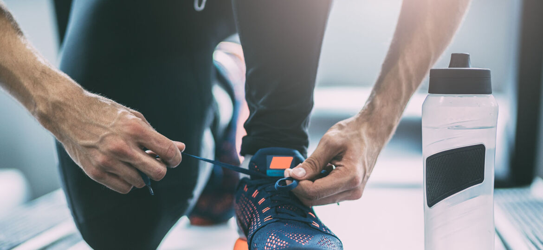 Portrait of a man tying shoelaces